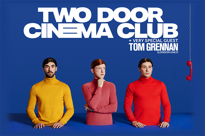 Image of the band Two Door Cinema Club on a blue background