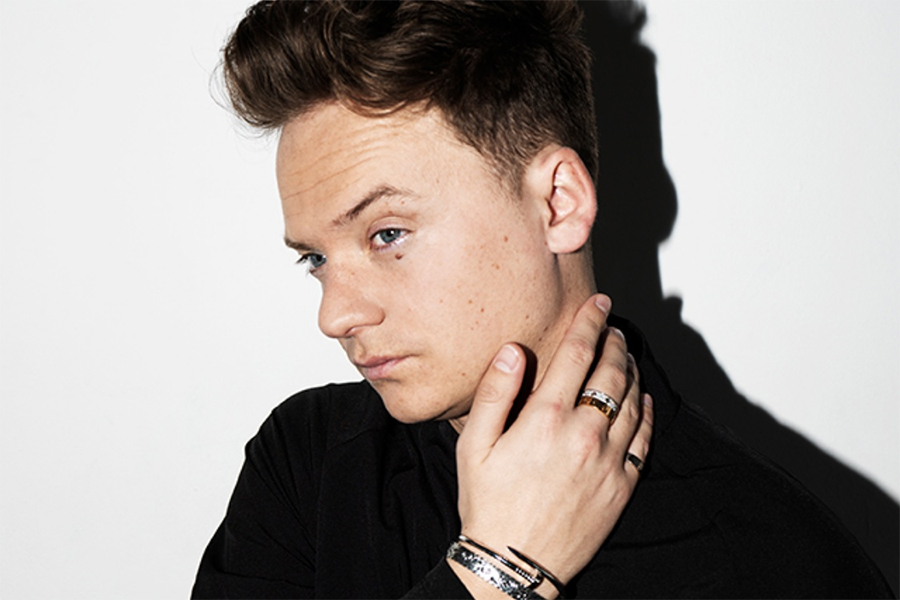 Photo of Conor Maynard on a light background