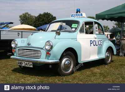 a-vintage-morris-minor-police-panda-car-at-a-classic-car-show-G3XNMM.jpg